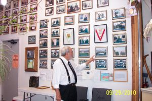 Pastor Yisrayl Hawkins pointing to a picture