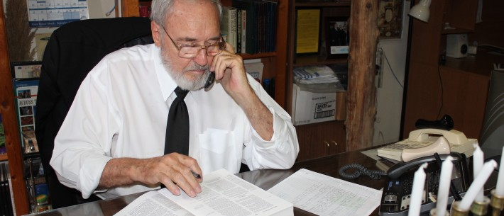 Yisrayl Hawkins at his desk, on the phone, teaching The Word of Yahweh.